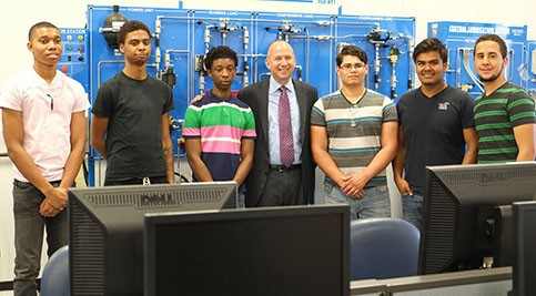Jack Markell touring ITC Center with 15 high school students