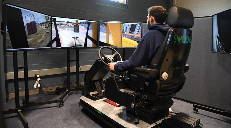 One of the operators using the construction simulator