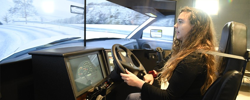 A student using the driving simulator at Delaware Tech's Middletown Training Center