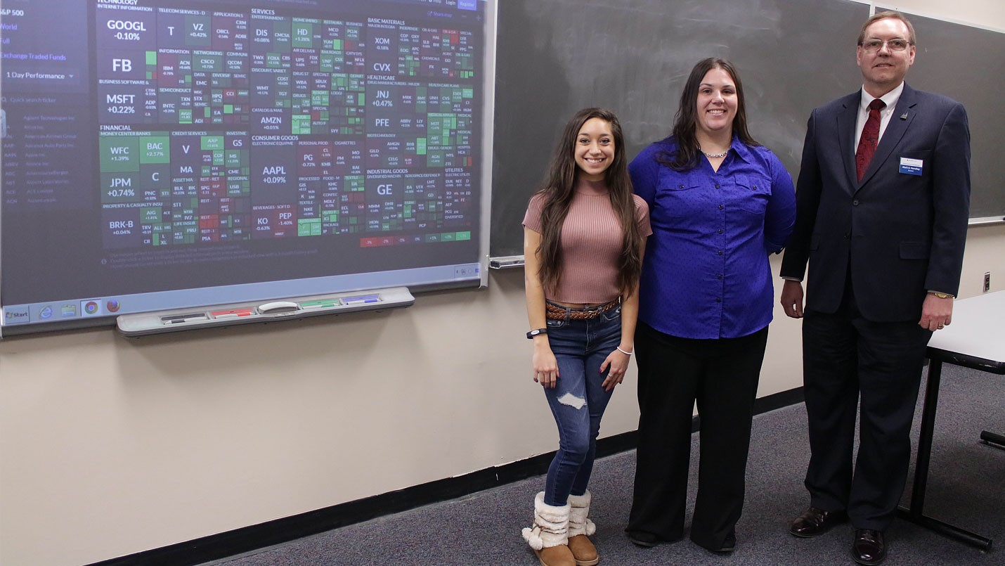 Team members Jessika Galindo and Maddison Toulson with faculty advisor Mark Handley