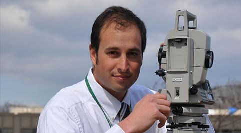 Ryan Phifer with surveying equipment