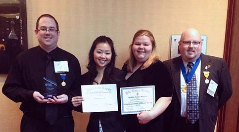 Alpha Beta Kappa members Eric Satter, Jennifer Hamblin, Riana Bright, and Jason Wallace display their awards at the Phi Theta Kappa regional conference March 2.