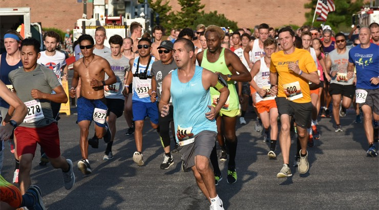 A large group of runners at the 2018 Run White and Blue event