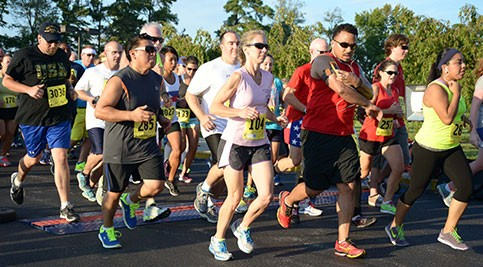 Runners take off at the start of the 2014 Run, White & Blue 5K.