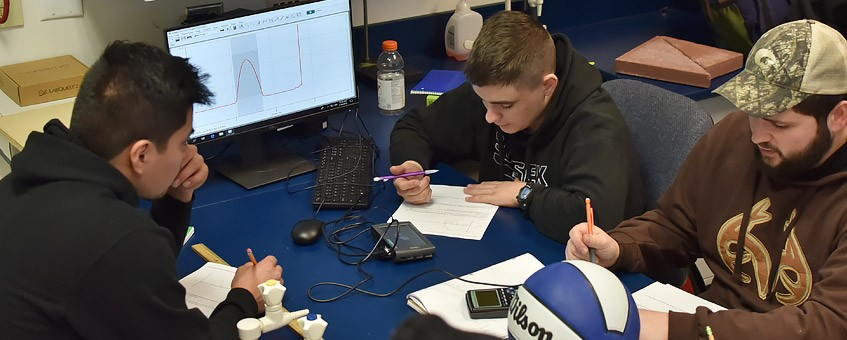 Students collaborate on a project in a science lab.