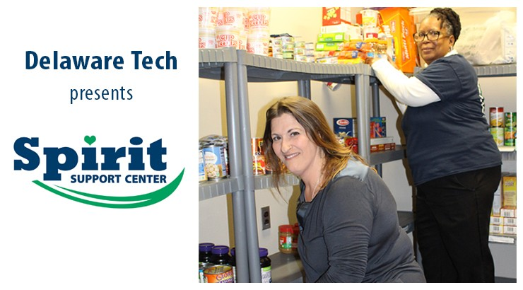 Two workers at the Spirit Support Center putting food on shelves