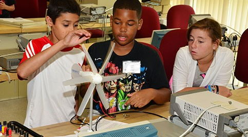 Middle school students perform hands-on lessons about renewable energy