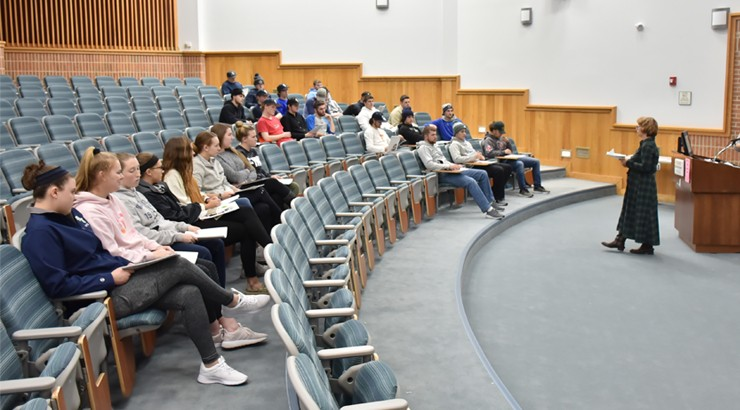 Delaware Tech softball and baseball players sitting in a lecture hall for the Darkness to Light session