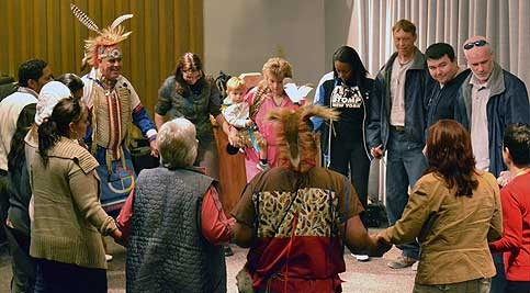 "Employees and students of Delaware Tech join Bruce ""Little Drummer"" Morris in a traditional Native American circle dance during a presentation on Native American Heritage in November."