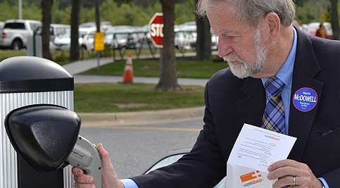 Sen. McDowell prepares to use Delaware Tech's electric car charging station to charge the Tesla Roadster.