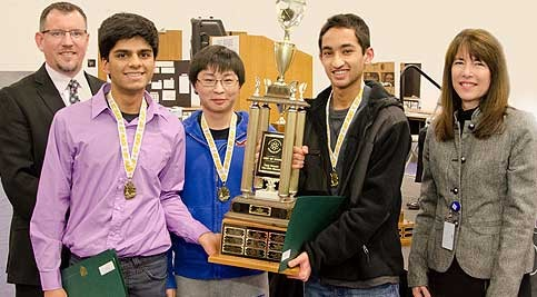 Students holding trophy with Delaware Tech representatives