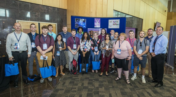 A large group of students at the conference