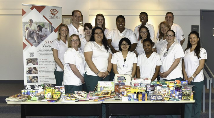 Nursing students in the Essentials of Maternal Child Health course pose next to the items they gathered to donate to the Alana Rose Foundation.