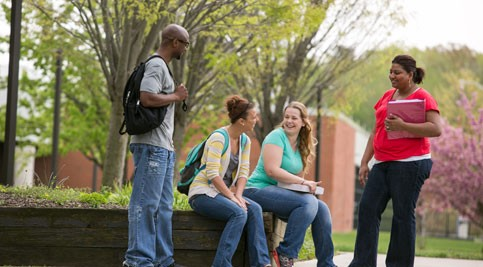 Four students in courtyard at Delaware Tech
