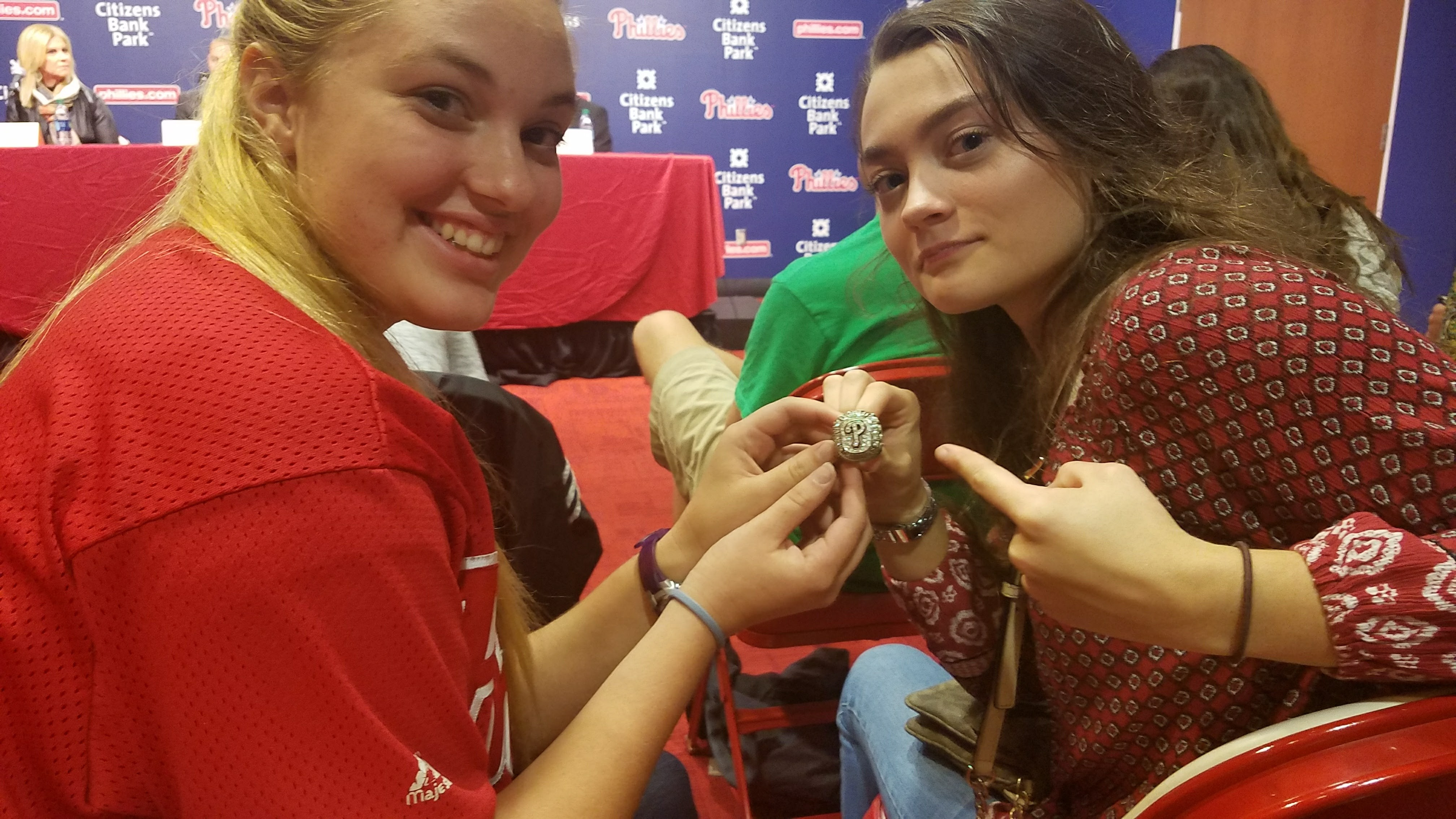 Communications students Olivia Tenefoss and Jana Ruark hold the Phillies World Series ring during the College Media Night.