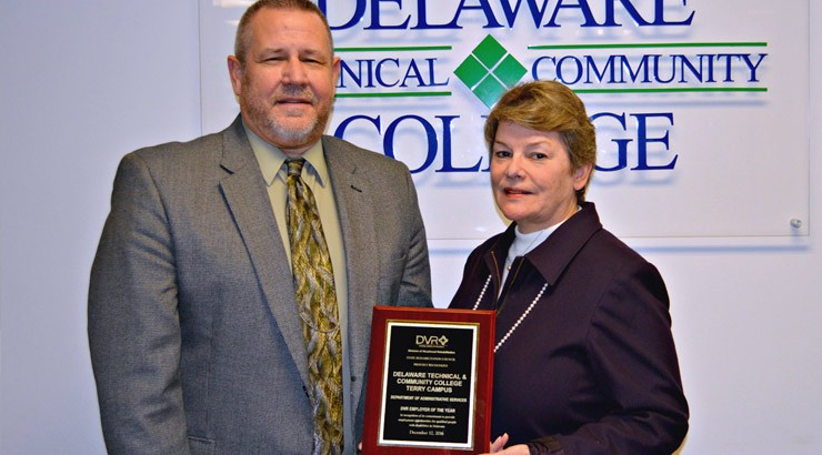Ray Parsons (left), director of Terry Campus administrative services, and Charlotte Lister, director of human resources, with the Outstanding Business Award for Kent County