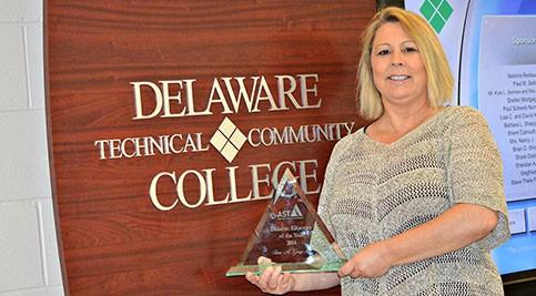 Tina Gary holds award