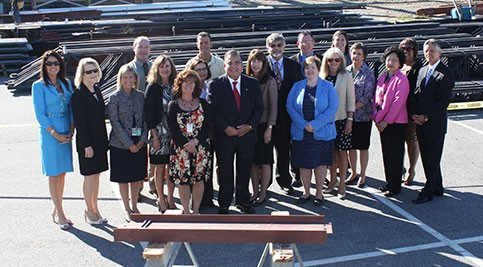 "Group posing at ""topping out"" ceremony"
