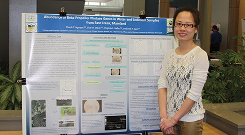 Thanah Nguyen in front of her poster board