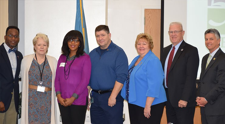 From left, Larence Kirby, Dr. Rebecca Craft, Delora McQueen,  Charlie Parker, Dr. June Turansky, Rep. Harvey Kenton and Dr. Mark Brainard after McQueen and Parker were honored for their work with Terry Campus student  veterans.