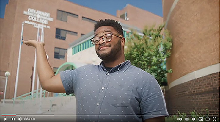 A screenshot of the viewbook video with a man standing in front of Delaware Tech's Wilmington Campus