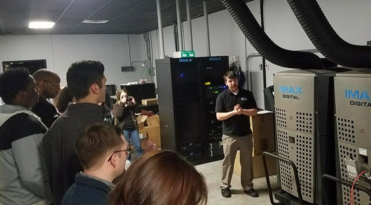 Delaware Tech students' tour of the IMAX theater at Penn Cinema Riverfront included getting a look at the IMAX projectors.
