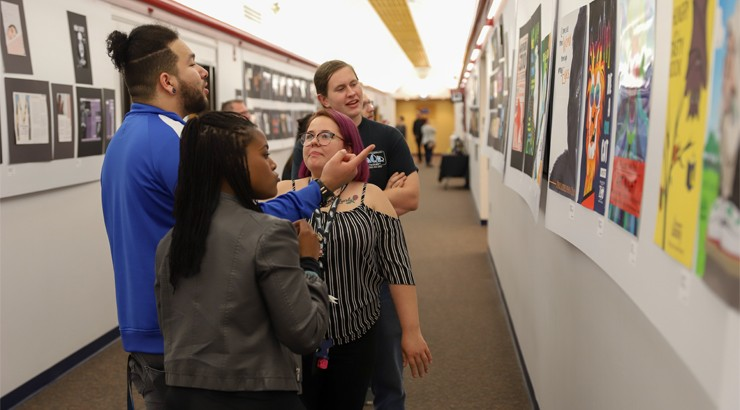 Guests admire some of the nearly 400 student works on display during the annual Visual Communications Student Showcase