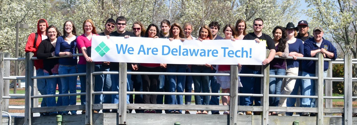 Group of students holding banner - We Are Delaware Tech!