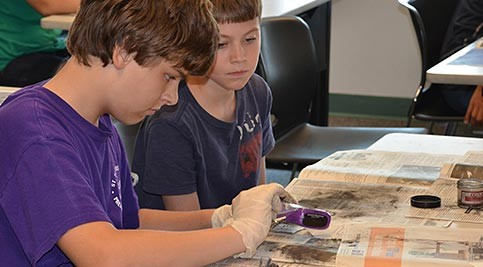 Two students use fingerprinting to solve a mystery