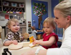 Female early education student in classroom with toddlers