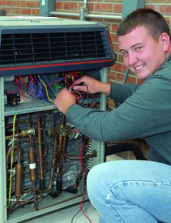 HVAC student working on air conditioner