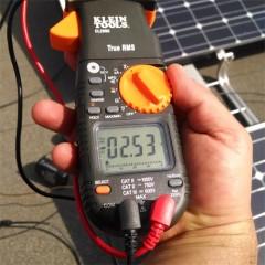 Renewable Energy - Solar student holding solar cell