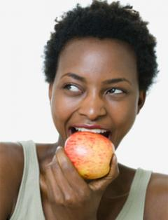 Female eating apple