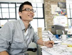 Multimedia student at desk sketching