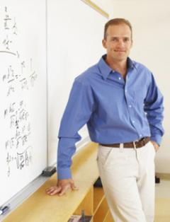 Male faculty member standing in front of smartboard