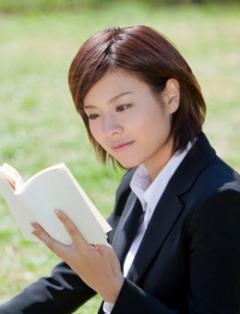 Female student reading outside