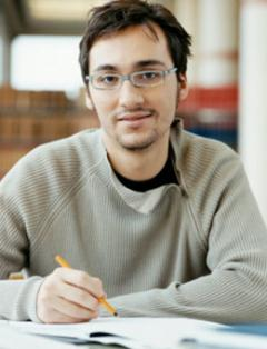 Male student working on writing a paper